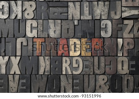 The word Trader written out in old letterpress blocks. - stock photo