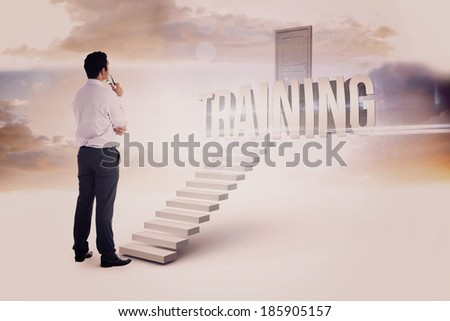 The word training and businessman holding glasses against white steps leading to closed door - stock photo