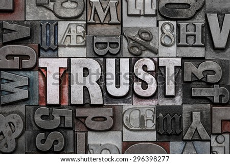 The word TRUST in old metal letterpress - stock photo