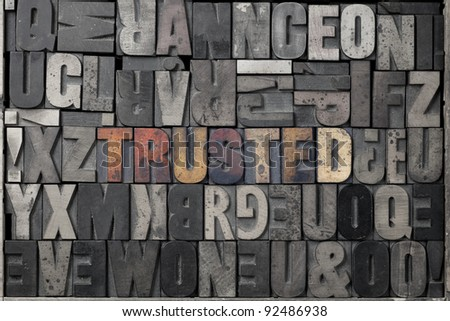 The word trusted written out in old letterpress blocks. - stock photo