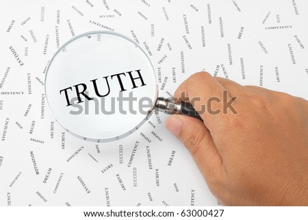 The word, TRUTH is magnified. - stock photo