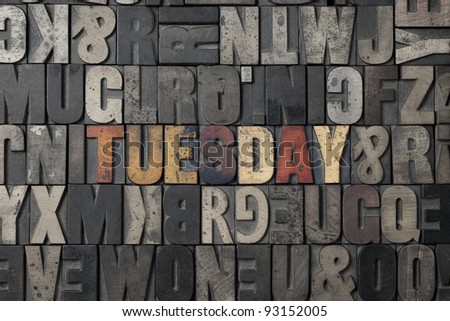 The word Tuesday written out in old letterpress blocks. - stock photo