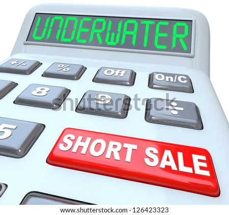 The word Underwater on a calculator digital display, symbolizing a home value being less than what is owed, and the words Short Sale on a red button symbolizing a solution to the problem - stock photo