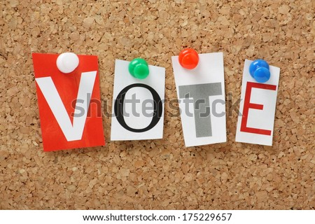 The word Vote in cut out magazine letters pinned to a cork notice board - stock photo