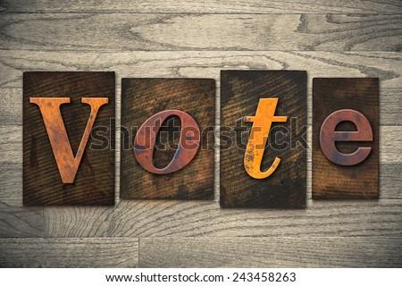 "The word ""VOTE"" written in wooden letterpress type. - stock photo"