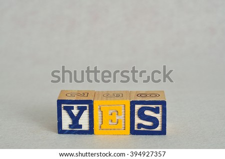 The word yes spelled with alphabet blocks isolated on a white background - stock photo