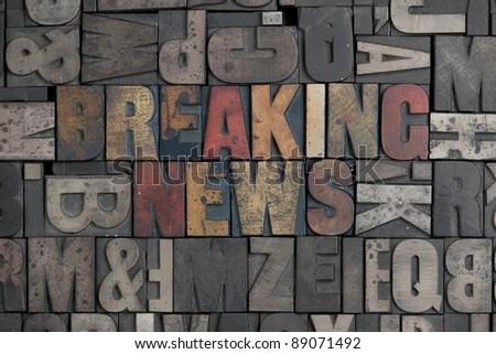 The words Breaking News written in very old letterpress type - stock photo