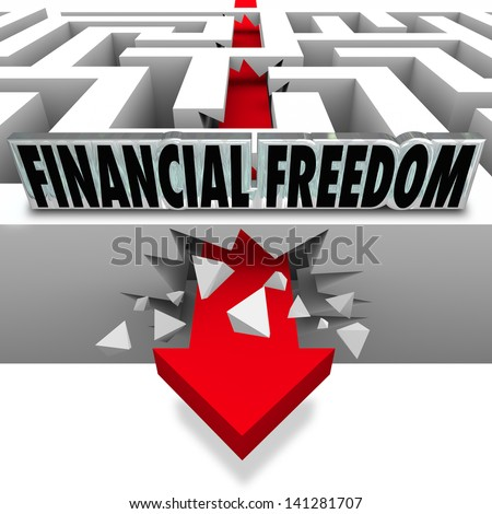 The words Financial Freedom over an arrow breaking through a maze to illustrate solving your money problems such as bills, debt, bankruptcy and insolvency to grow your wealth - stock photo