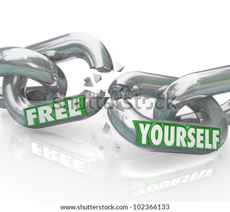 The words Free Yourself on chain links breaking apart representing a fight for freedom and liberation from oppressive rules and authority figures binding you from being freed - stock photo