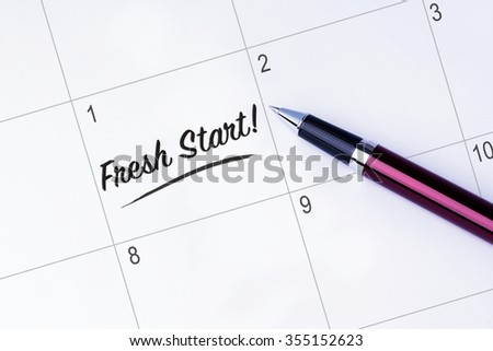 The words Fresh Start on a calendar planner to remind you an important appointment with a pen on isolated white background. New Year concepts of goal and objective. - stock photo