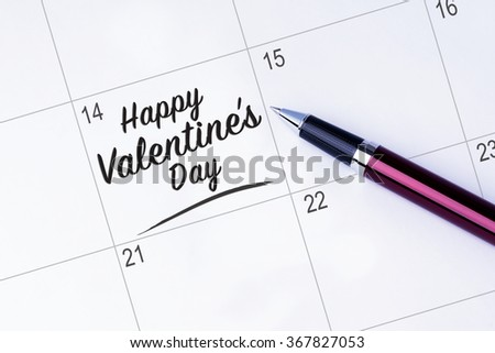 The words Happy Valentine's Day written on a calendar planner to remind you an important appointment with a pen on isolated white background. Valentine's Day and Love Concepts - stock photo
