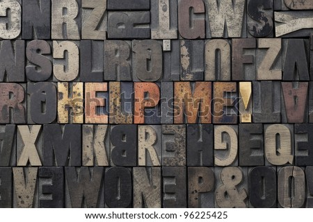 The words Help Me written in antique letterpress printing blocks. - stock photo