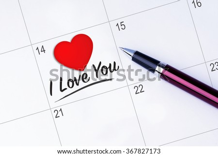 The words I Love You and a Heart Shape written on a calendar planner to remind you an important appointment with a pen on isolated white background. Valentine's Day and Love Concepts - stock photo