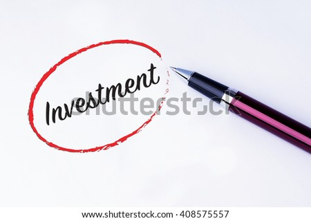 The words Investment written in a red circle to remind you an important appointment with a pen on isolated white background. New Year concepts of goal and objective. - stock photo