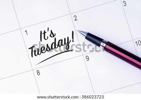 The words It's Tuesday written on a calendar planner to remind you an important appointment with a pen on isolated white background.  - stock photo