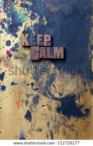 The words Keep Calm written in antique letterpress printing blocks. - stock photo