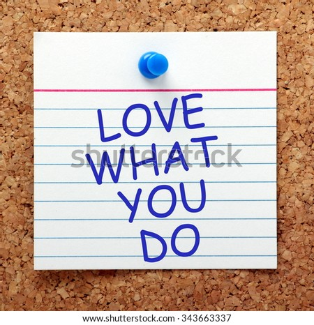 The words Love What You Do in blue text on an index card pinned to a cork notice board as a reminder - stock photo
