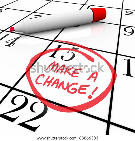 The words Make a Change circled on a calendar with a pen beside the written message reminder - stock photo