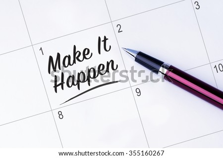 The words Make It Happen on a calendar planner to remind you an important appointment with a pen on isolated white background. New Year concepts of goal and objective. - stock photo