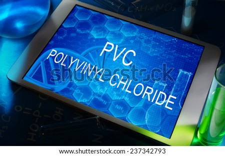 the words PVC (Polyvinyl chloride) on a tablet with test tubes   - stock photo