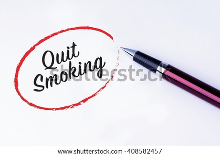 The words Quit Smoking written in a red circle to remind you an important appointment with a pen on isolated white background. New Year concepts of goal and objective. - stock photo