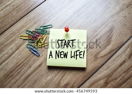 The words Start a New Life written on a sticky note  - stock photo