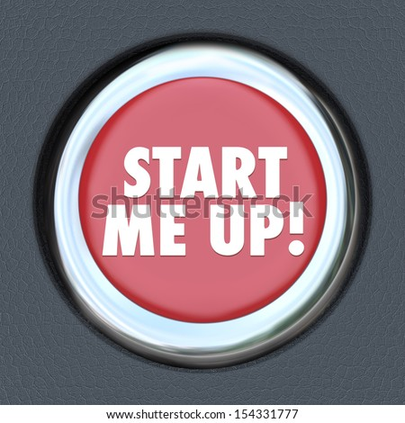 The words Start Me Up on a round car start ignition button to illustrate getting excited, motivated, encouraged and aroused for the beginning of a race, game or other exciting event - stock photo