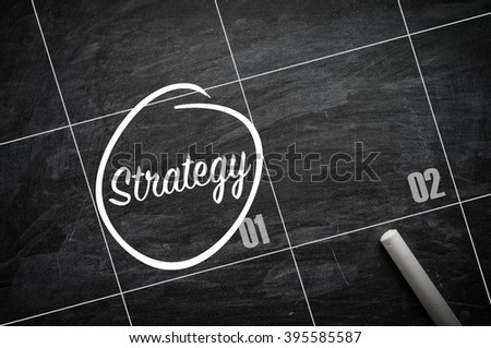 The words Strategy  and circled on a blackboard to remind important appointment - stock photo