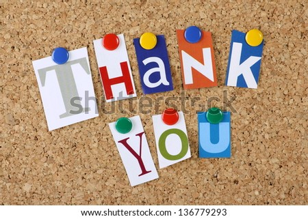 The words Thank You in cut out magazine letters pinned to a cork notice board - stock photo