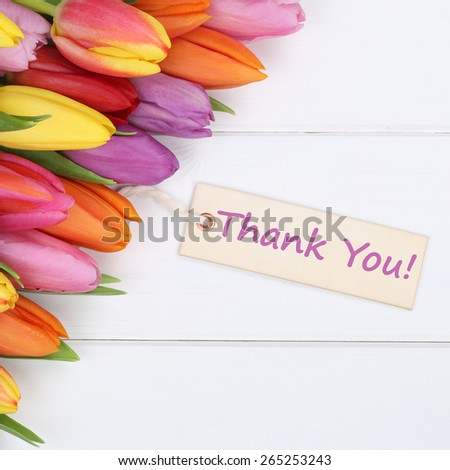 The words Thank You with tulips flowers as a gift - stock photo