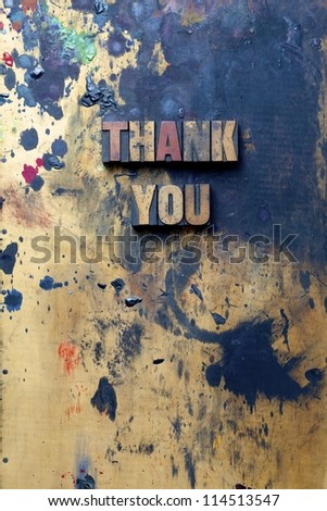 The words Thank You written in very old and well used letterpress type. - stock photo