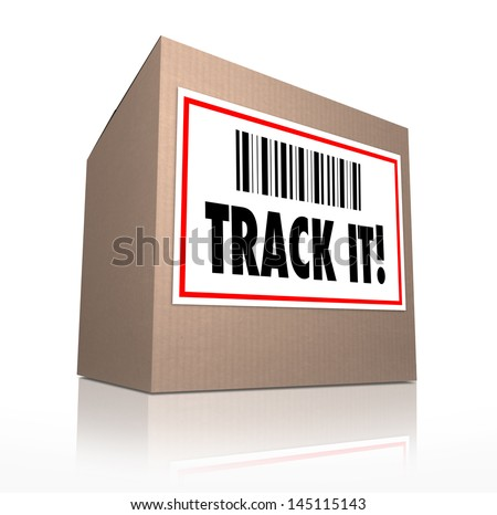 The words Track It with barcode on a package shipment label to trace the shipment of a cardboard box shipped in the mail or by courier - stock photo
