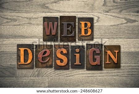 "The words ""WEB DESIGN"" written in vintage wooden letterpress type. - stock photo"