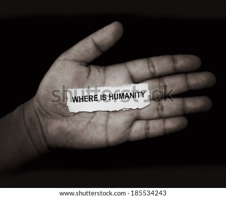"the words ""where is humanity"" in paper on hand - stock photo"