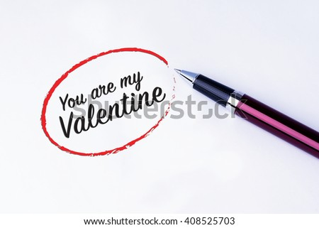 The words You are my Valentine in a red circle to remind you an important appointment with a pen on isolated white background. Valentine's Day and Love Concepts - stock photo