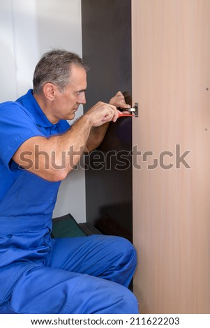The worker build a wardrobe - stock photo
