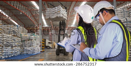 The worker report and check stock in sugar distribution warehouse - stock photo