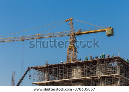 The workers are building a building. - stock photo