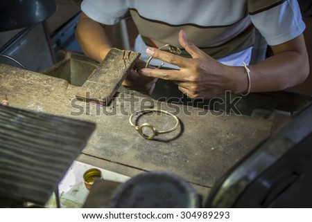 The working of silver smith - stock photo
