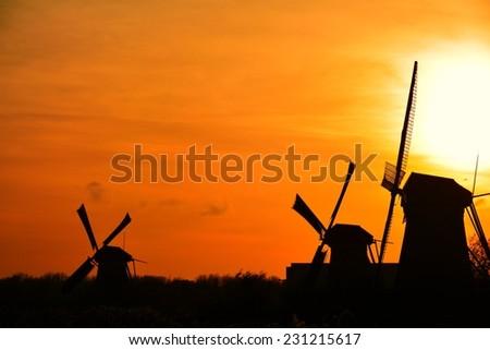 The world Heritage Kinderdijk windmills landscape at dusk, the Netherlands. - stock photo