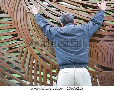 The world in his hands. - stock photo