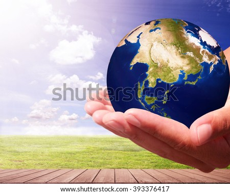 The world is on hold for the Meadow bokeh blur background. earth social in human the hand. Businessman holding planet Earth in palm. Elements of this image furnished by NASA. - stock photo