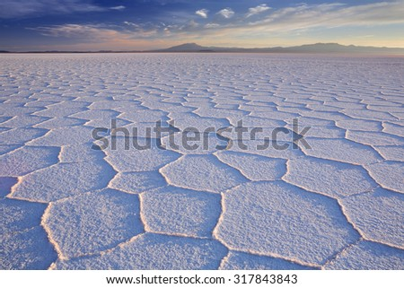 The world's largest salt flat, Salar de Uyuni in Bolivia, photographed at sunrise. - stock photo