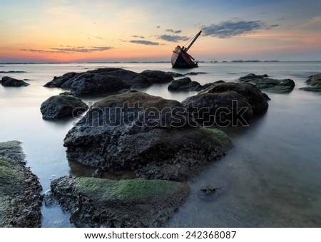 The wrecked ship on stone beach, Thailand - stock photo