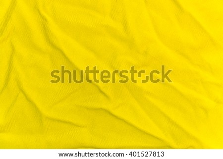 The wrinkled bright yellow knitted fabric for the background - stock photo