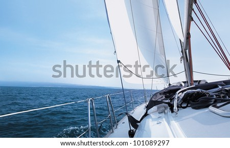 The yacht is moving along the coast - stock photo