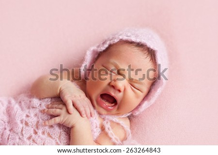 The yawning newborn girl - stock photo