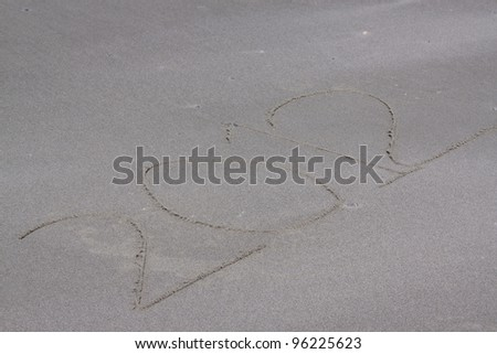 The year 2012 written in sand along the coast - stock photo