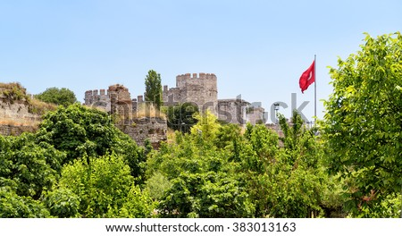 The Yedikule Fortress (Castle of Seven Towers) and ancient walls of Constantinople with Turkish flag in Istanbul, Turkey - stock photo