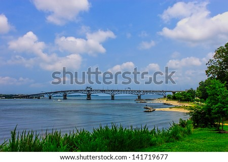 The York river and beach in Yorktown Virginia overlooking the Coleman Bridge and the Chesapeake Bay during a summer day - stock photo